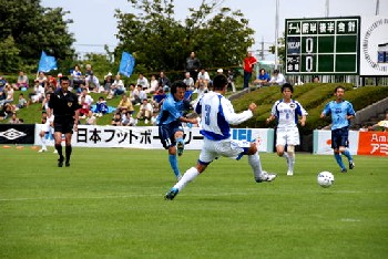 02 Jul 06 - YKK's Kohei Onishi goes for goal in the Toyama derby match with Alo's