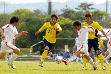 04 Apr 06 - New Wave's Manabu Kubota (middle) tries to rob a small boy of the ball