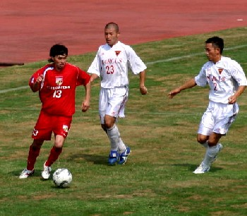 06 Aug 06 - Shinya Kobayashi in possession for Luminozo against Marcus