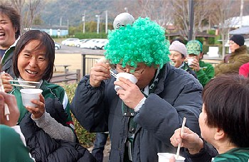 17 Dec 06 - Some of Gifu's dorkier fans slurp down a half-time snack