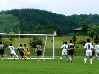 18 Jun 06 - Tokachi Fairsky in... grey? Brown? defend against Sapporo Football Group