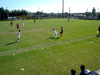 21 Nov 05 - Minami FC in white on the way to defeat against the mysterious 揚茜クラブ
