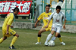 22 Oct 06 - Kamatamare star striker Eiji Morita shields the ball against Shimanami