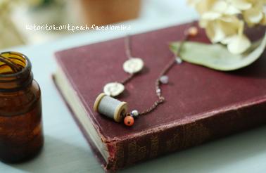 糸巻きネックレス1