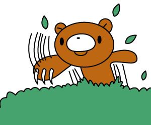 草むらから出るクマ