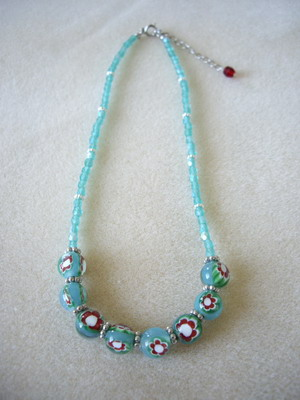 red flower on green glass beads necklace